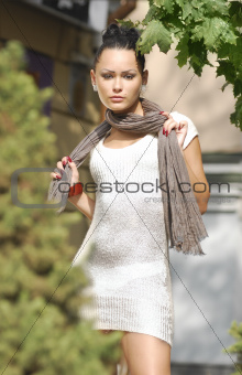 pretty young woman in autumnal city