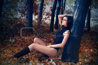 A young beautiful woman in the autumn forest