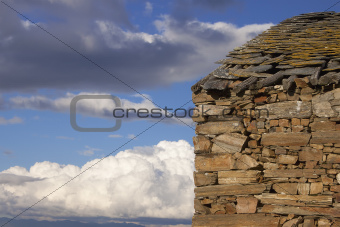 Stone house and clouds.