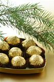 chocolate truffles in a gift box under the Christmas tree