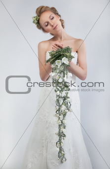 Pretty woman fiancee blond with bunch of fresh gentle flowers