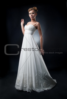 Romantic pretty bride fashion model shows white wedding dress