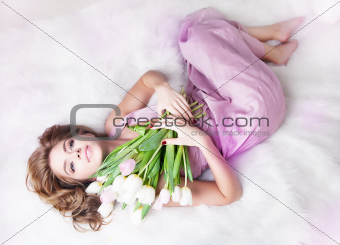 Pretty sexy gentle young woman with bouquet of fresh tulips