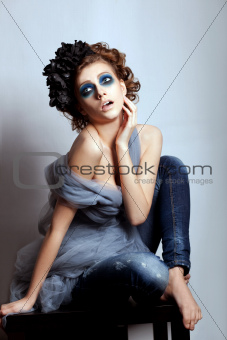 Woman artistic face with bright blue makeup. Fantasy, glamour