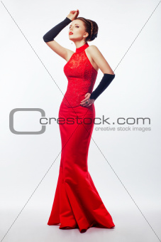 Pretty woman in red long bridal dress. Wedding. Beauty bride