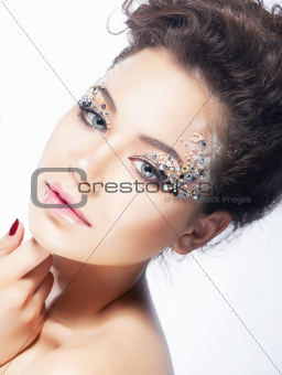Young beauty woman face. Bright coiffure and make-up