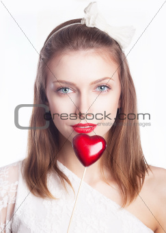 Beautiful smiling girl, red heart shape symbol - valentine s day