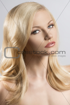 beauty portrait of pretty blonde girl turned at left