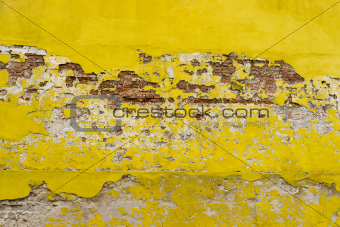 brick wall with grunge yellow plaster
