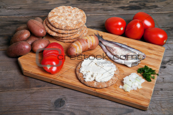 Swedish herring and ingredients on the cutting board