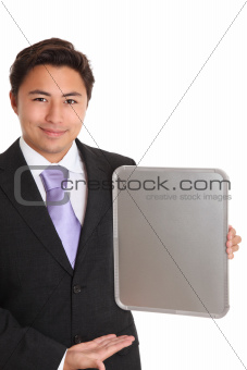 Businessman with a chrome sign showing