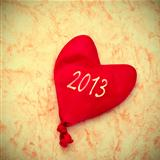 2013 written in a heart-shaped balloon