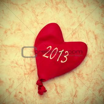 2013 written in a heart-shaped balloon