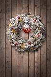 White Christmas wreath on wooden door