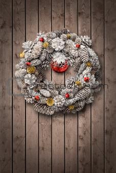 White Christmas wreath on wooden door