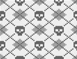 Seamless knitted pattern with skulls