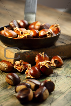 Frying pan and roast chestnuts.
