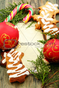 Christmas balls, gingerbread and candy cane.