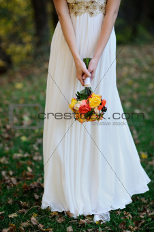 bride holds a bouquet