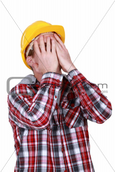 Devastated construction worker