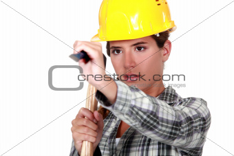 Young woman using a hammer