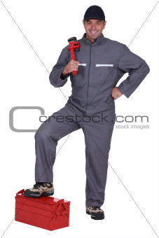 Man with a wrench and toolbox