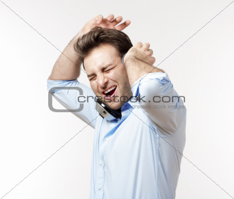 excited man in blue shirt with earphones listening to music