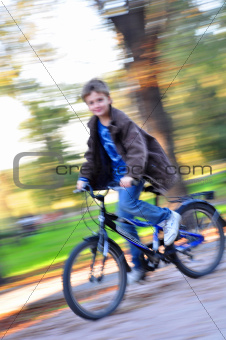 happy boy riding bike