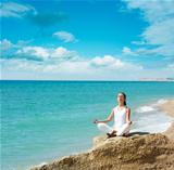 Woman Doing Yoga near the Sea