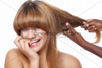 Smiling beauty getting her hair done