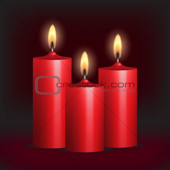 Three red burning candles on black background.