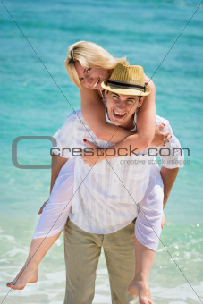 Happy young couple on tropical beach