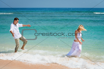 Playful young couple have a fun in tropical sea