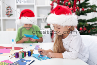 Kids making christmas greeting cards