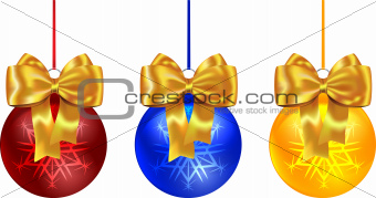 Colorful Christmas balls tied with yellow bow