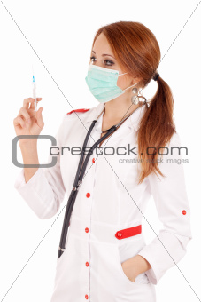 Young doctor holding syringe