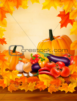 Autumn vegetable on wooden background with leaves