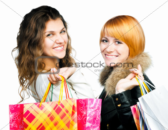 teenage girls with shopping bags