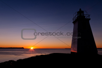 Lighthouse during sunrise in the early morning 