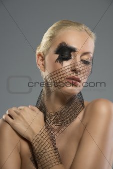 portrait of girl with creative make-up, she looks down
