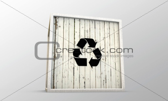 wooden crate with recycle symbol