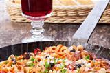 Mediterranean pasta dish in an iron pan
