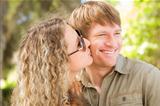 Happy Attractive Loving Couple Portrait in the Park.