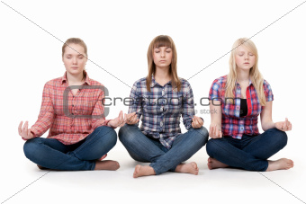 Three girls sitting in lotus posture