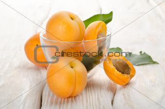 Apricots on a wooden background