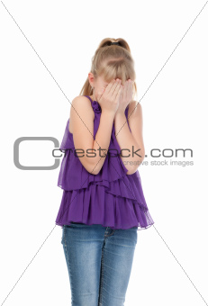 Young girl shyly covered her face with her hands
