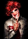Evil Blood Stained Clown Contemplating Homicide
