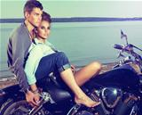 Romantic couple family resting on lake shore - motorbike