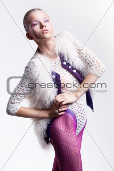 Glamour beauty. Fashion woman posing in fur white vest