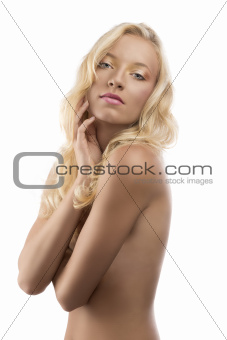 pretty blonde girl with naked torso and hand near the face